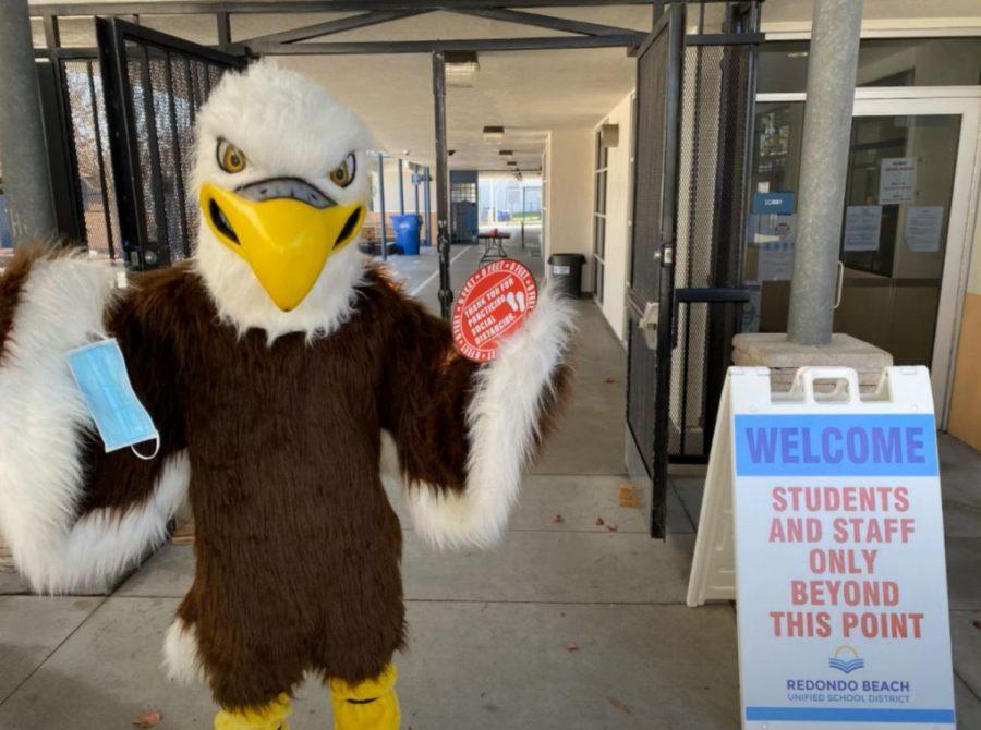 Adams' Middle School's mascot, Steve the Eagle, welcomes students back. Photo via Adams 6th Grade Return Presentation on Youtube