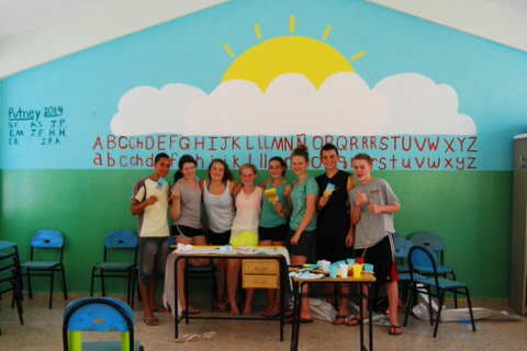 Photo courtesy of Alison Shafer. Shafer and her peers paint the wall inside of a classroom for young local children.