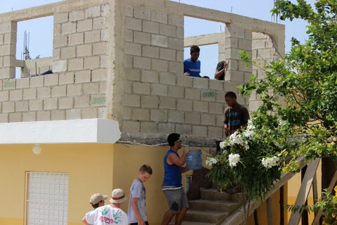 Photo courtesy of Alison Shafer. Shafer and her service group refurbishes a school in two weeks.