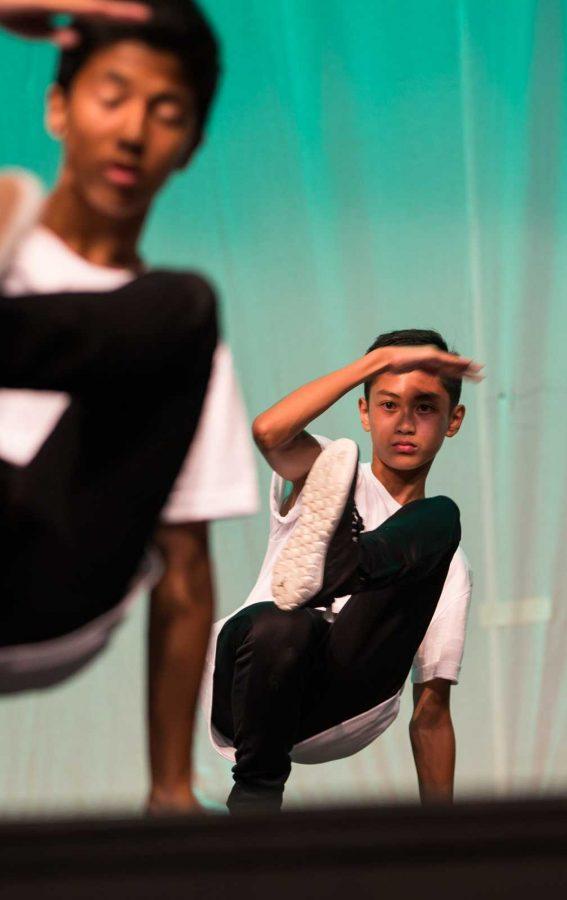 Junior Luigi Lopez performing with teammate at the SPF 8.0 showcase.