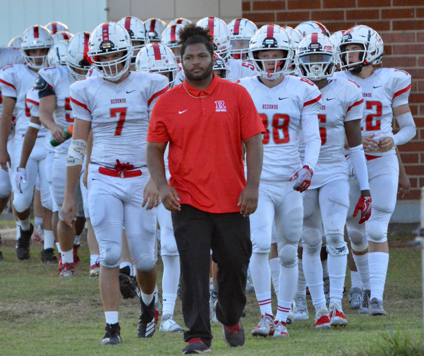 Varsity football heads onto the field for warm-ups. PHOTO COURTESY OF GEOFF MALEMAN