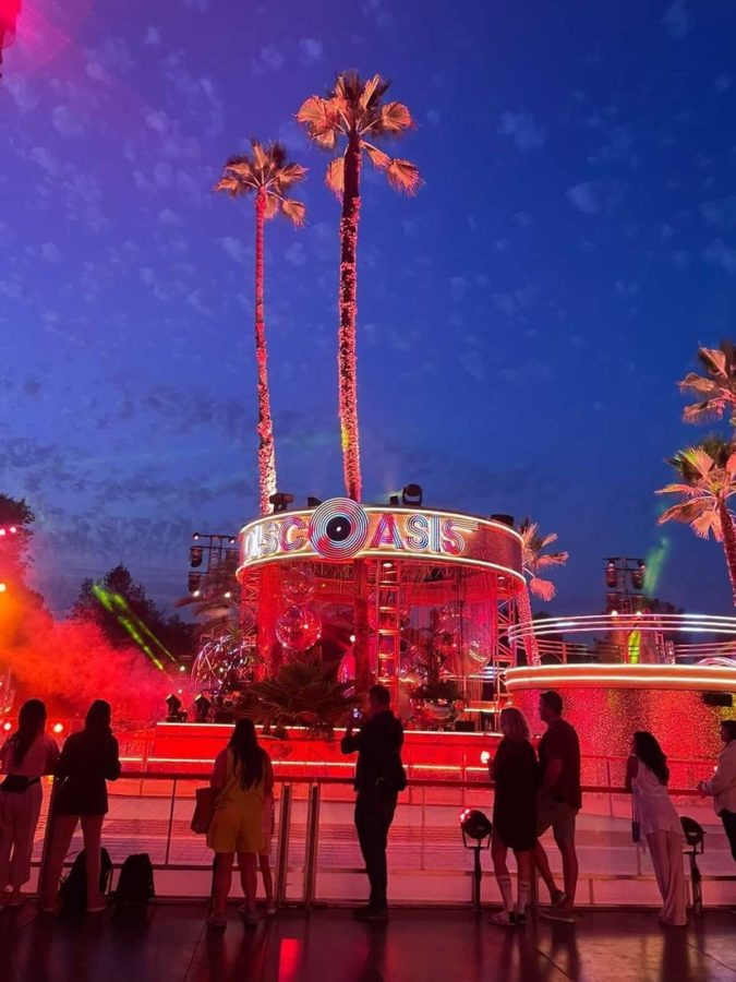 Skaters enjoy the colorful lights and loud music as they watch and take a break. PHOTO COURTESY OF NATALIA QUESADA